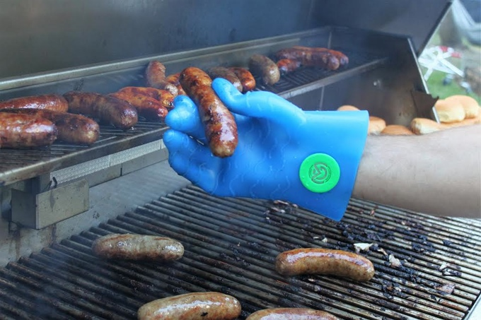 Magnefuse BBQ glove silicone product prototype test on a grill with a sausage in a South Florida yard