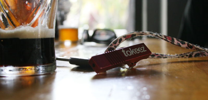 tokeez manufactured novelty smoking product prototype on a bar counter